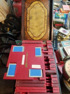 I have this case that has multiple trays of cards. There's no name anywhere. The trays are num